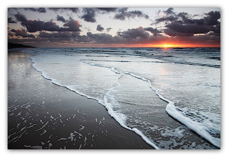 Sunset at the sea with dark clouds
